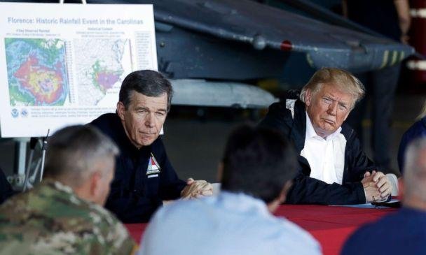 PHOTO: President Donald Trump and North Carolina Gov. Roy Cooper listen while attending a briefing, after Trump arrived at Marine Corps Air Station Cherry Point to visit areas impacted by Hurricane Florence, Sept. 19, 2018, in Havelock, N.C. (Evan Vucci/AP)