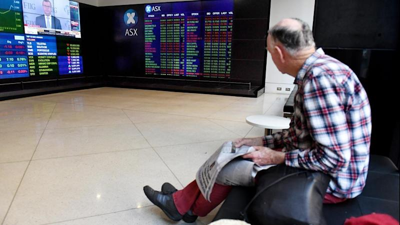 The share market looks set to open slightly lower after falls on Wall Street.