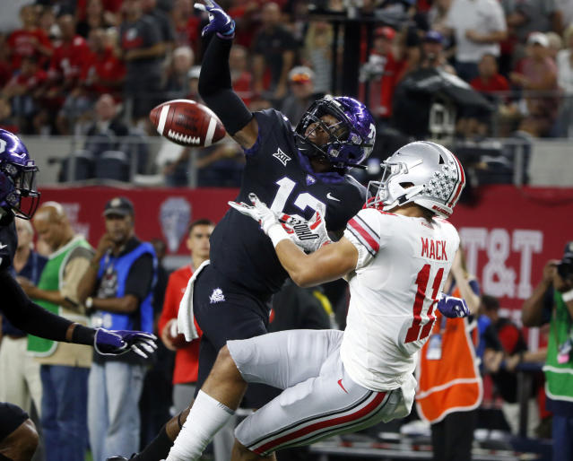 TCU cornerback Jeff Gladney (12) defends a pass intended for Ohio State wide receiver Austin Mack during the first half of an NCAA college football game in Arlington, Texas, Saturday, Sept. 15, 2018. (AP Photo/Michael Ainsworth)