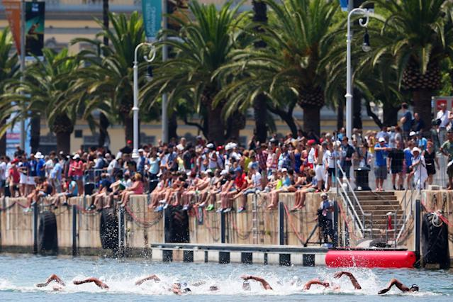 BARCELONA, SPAIN - JULY 20: Spectators watch the Open Water Swimming Men's 5k race on day one of the 15th FINA World Championships at Moll de la Fusta on July 20, 2013 in Barcelona, Spain. (Photo by Alexander Hassenstein/Getty Images)