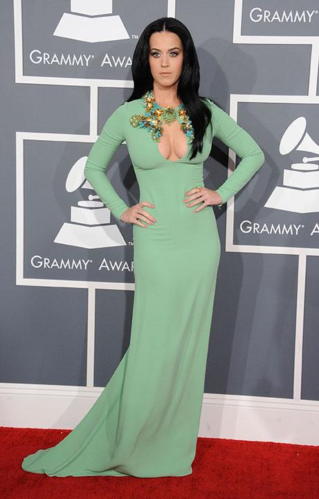 Katy Perry shows off her curves and cleavage in a tight mint green Gucci dress. She adds focus on her décolletage with the intricate beading.