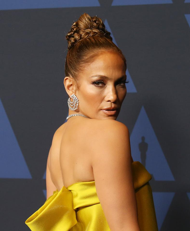 <p>Lopez attended the Governor Awards donning an architectural braided hairstyle with slicked-back hair and a braid that snaked around the updo's base and down to the left side.</p>