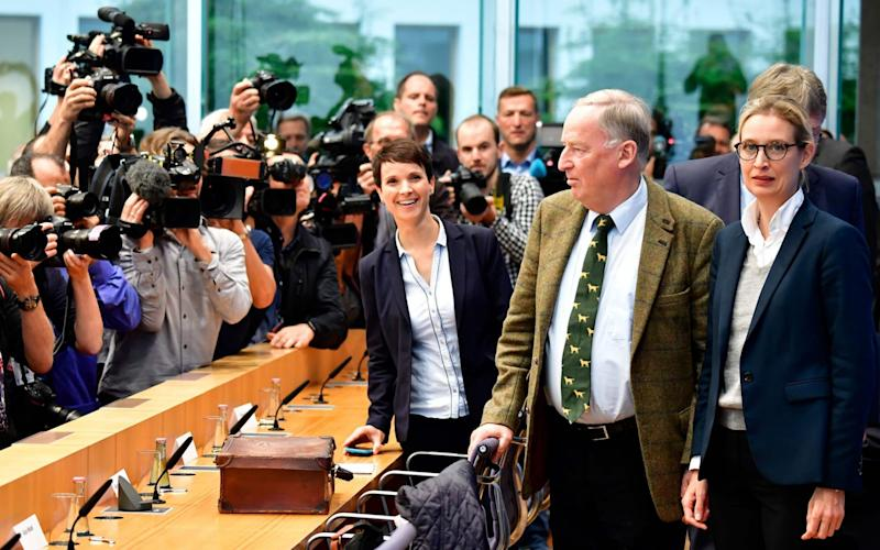 Frauke Petry (left) stunned party colleagues, including top candidates Alexander Gauland (centre) and Alice Weide (right), when she announced she would not take up the AfD party whip in parliament - AFP