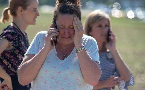 Instructional Assistant Paige Rose reacts outside Noblesville West Middle School - Credit: Getty