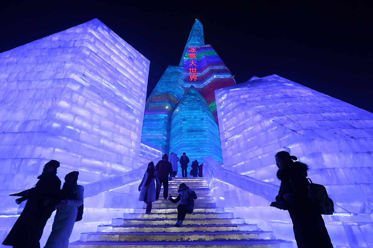 <p>People visit ice sculptures illuminated by colored lights at Harbin International Ice and Snow Festival in Harbin, China, Jan. 5, 2017. (Photo: WU HONG/EPA) </p>