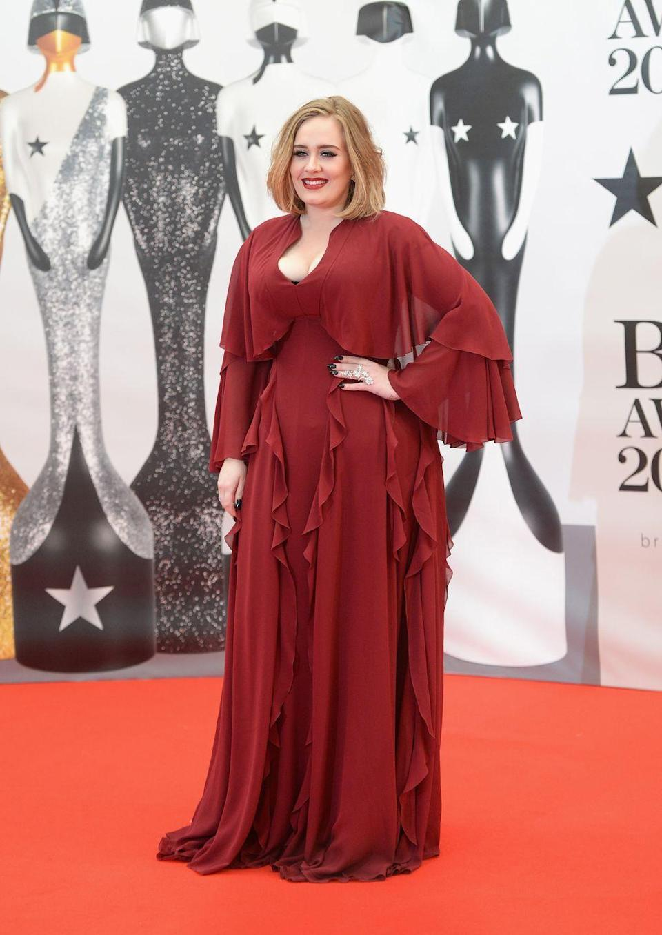 <p>Adele embraced colour at the 2016 Brit Awards, walking the red carpet in this flowing Giambattista Valli dress with gently cascading ruffles. </p>