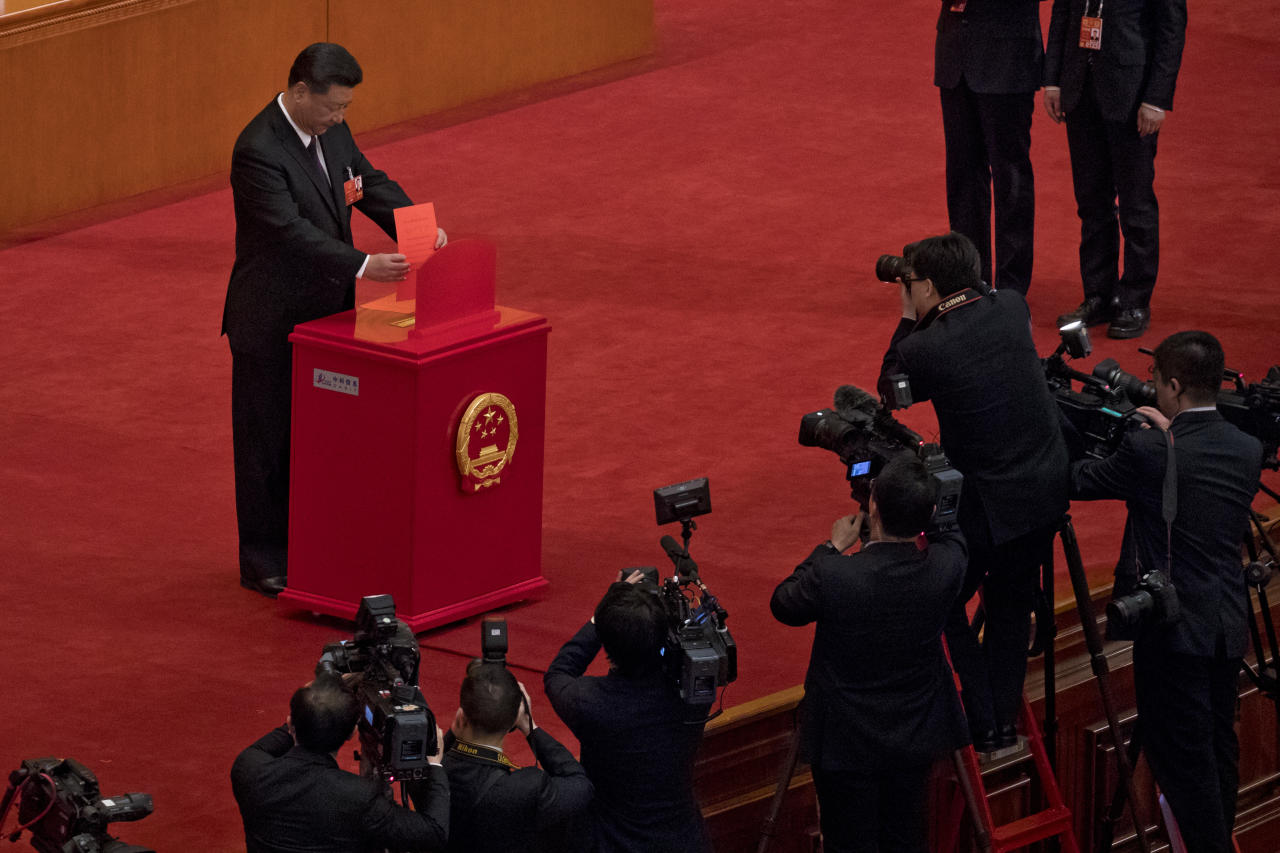 <p> In this Saturday, March 17, 2018, photo, Chinese journalists film Chinese President Xi Jinping casts his ballot during a plenary session of China's National People's Congress at the Great Hall of the People in Beijing. The Chinese Communist Party's move to exert direct control over state broadcasters and regulators of everything from movies and TV to books and radio programs shows the party's drive to use the media for ideological efforts at home and to improve its image overseas, analysts say. The move is part of a push by Xi to tighten party supervision over much of Chinese public life as he renews his uncontested rule free of constitutional limits on his terms in office. (AP Photo/Andy Wong) </p>