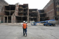 Buildings damaged Dec. 25, 2020, in a suicide bombing are seen Friday, June 25, 2021, in Nashville, Tenn. Six months after a Christmas Day bombing ripped a hole in historic downtown, workers continue to chip away at cleanup efforts so that revitalization can begin. The tediously slow process has meant workers haven't been able to access some of the buildings until recent weeks. (AP Photo/Mark Humphrey)