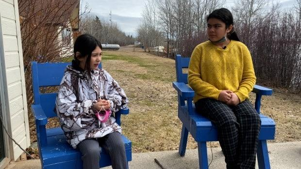 Kierstyn Hope, left, and Shaylyn Hope, right, talk about how they found some of the first signs of high water levels at their home in Jean Marie River, N.W.T.