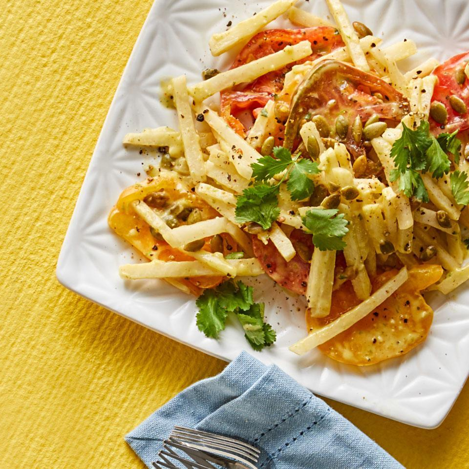 <p>If you're looking for a way to jazz up your tomato salad, try this take with jicama--it's a root vegetable that tastes like pears. Its mild, refreshing flavor and distinct crunch make it perfect for summer. Look for sliced or whole jicama in the produce section. The creamy avocado dressing would be great on all sorts of salads.</p>