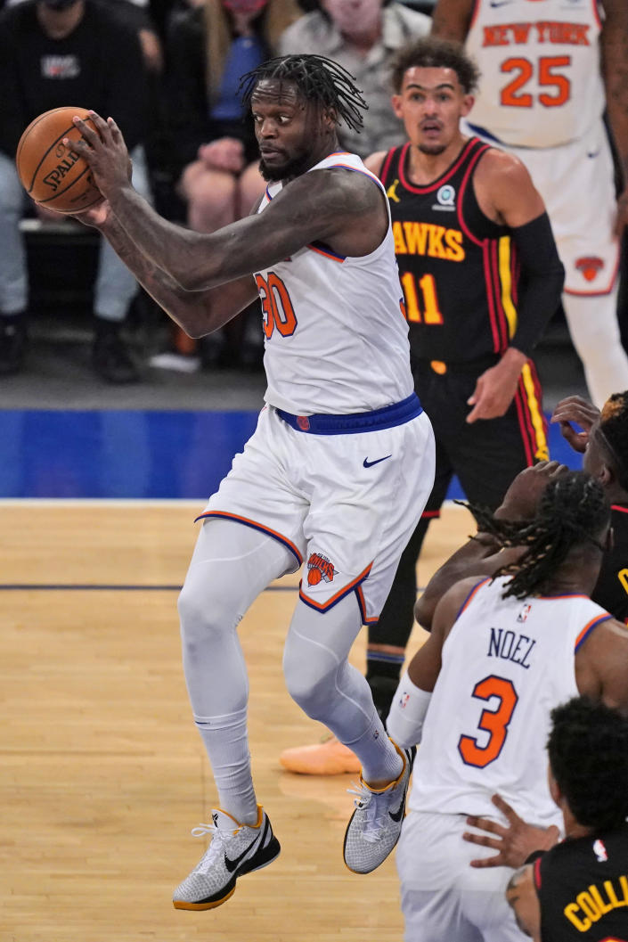 New York Knicks' Julius Randle looks to pass during the first half of Game 1 of an NBA basketball first-round playoff series against the Atlanta Hawks, Sunday, May 23, 2021, in New York. (AP Photo/Seth Wenig, Pool)