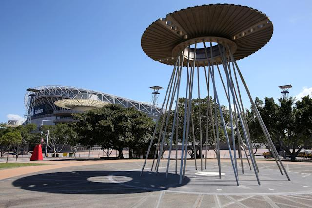 The Sydney Olympic Cauldron stands across from the Olympic Stadium in Sydney, Monday, Feb. 24, 2014. Before the 2000 summer Olympics, the site west of Sydney where the 1580-acre Sydney Olympic Park was built was a grungy, desolate wasteland of slaughterhouses, garbage dumps and factories. Since the games, it has slowly developed into its own suburb with hotels, offices, restaurants and parklands. The park now hosts thousands of events each year, from music festivals to sports to business conferences, drawing more than 12 million annual visitors. (AP Photo/Rick Rycroft)