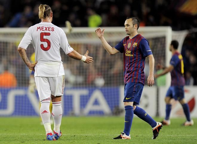 AC Milan's French defender Philippe Mexes ahakes hands with Barcelona's midfielder Andres Iniesta (R) at the end of the Champions League quarter-final second leg football match FC Barcelona vs AC Milan on April 3, 2012 at Camp Nou stadium in Barcelona. FC Barcelona defeated AC Milan 3-1 to reach the semi-finals.  AFP PHOTO / LLUIS GENE