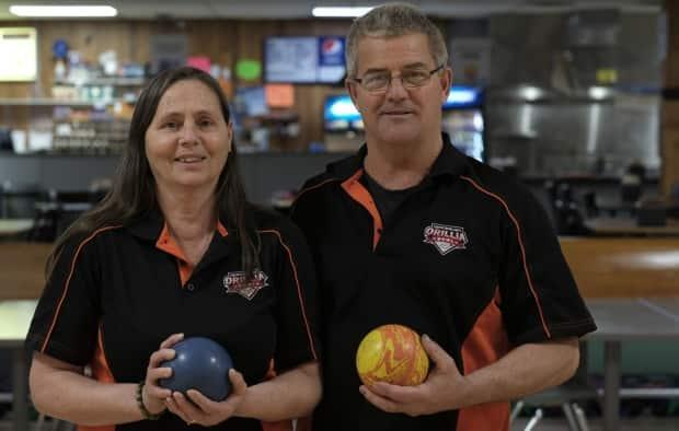 Kathy Rainey, left, is a second-generation bowling alley owner - her parents ran one too - while Andy once shot a perfect game. They realized their dream of owning a bowling alley when they bought Orillia Bowl in 2013.  (Nick Purdon/CBC - image credit)