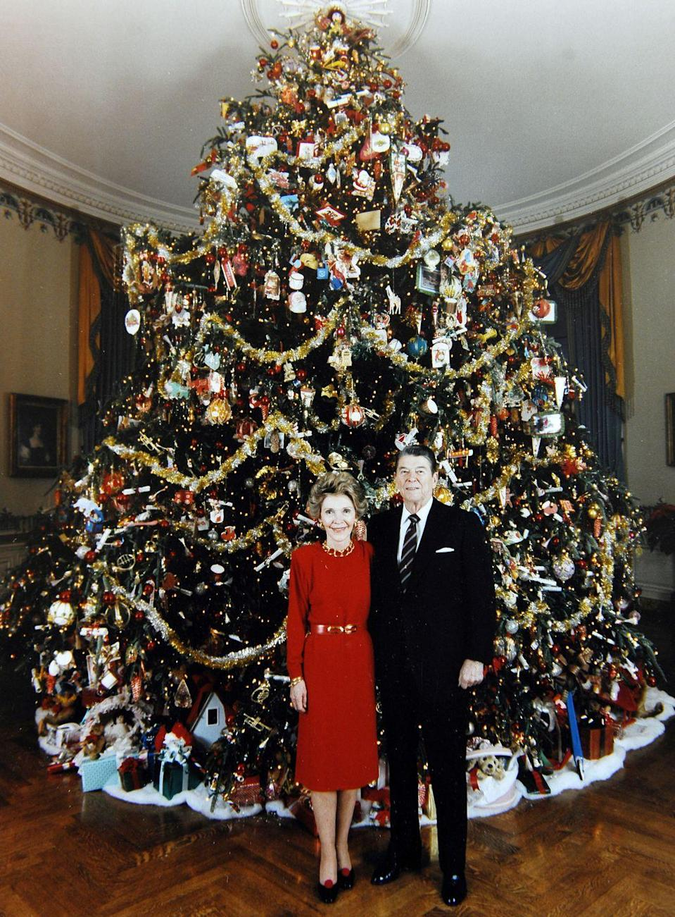 <p>The Reagans stood in front of the thoroughly decorated White House Christmas tree, an 18.5-foot Fraser fir. </p>