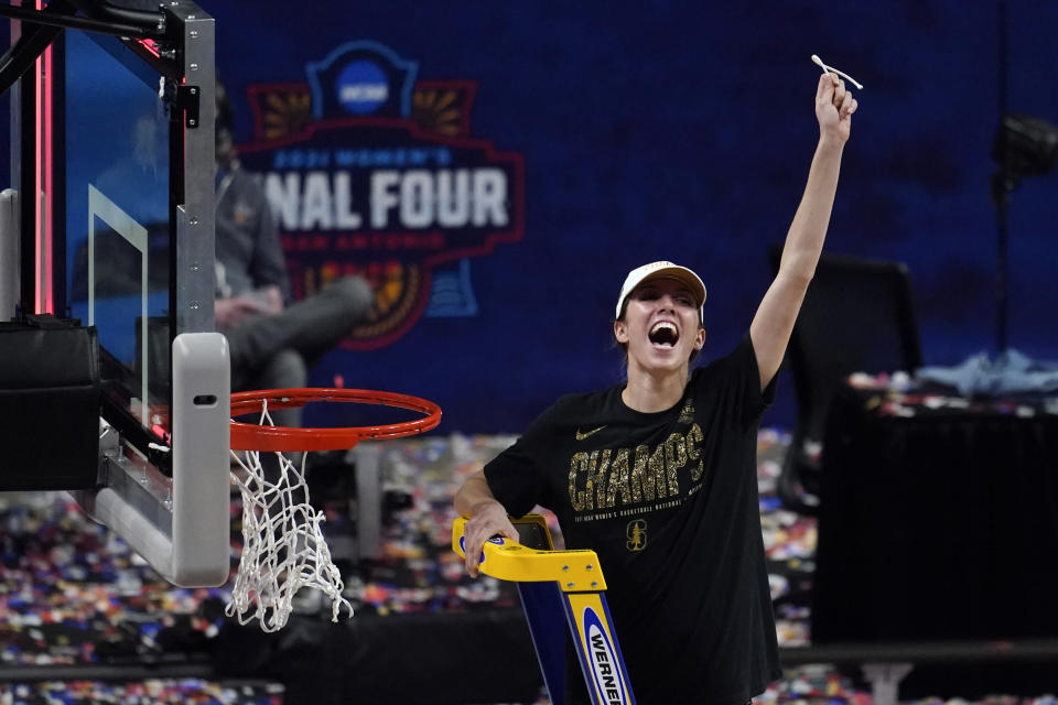Stanford guard Lexie Hull cuts down the net after the championship game against Arizona in the women's Final Four NCAA college basketball tournament, Sunday, April 4, 2021, at the Alamodome in San Antonio. Stanford won 54-53. (AP Photo/Eric Gay)