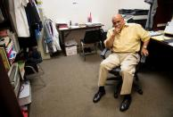 Reverend Israel Suarez reflects on his time in the hospital with the coronavirus disease (COVID-19), while sitting in his office in Fort Myers, Florida