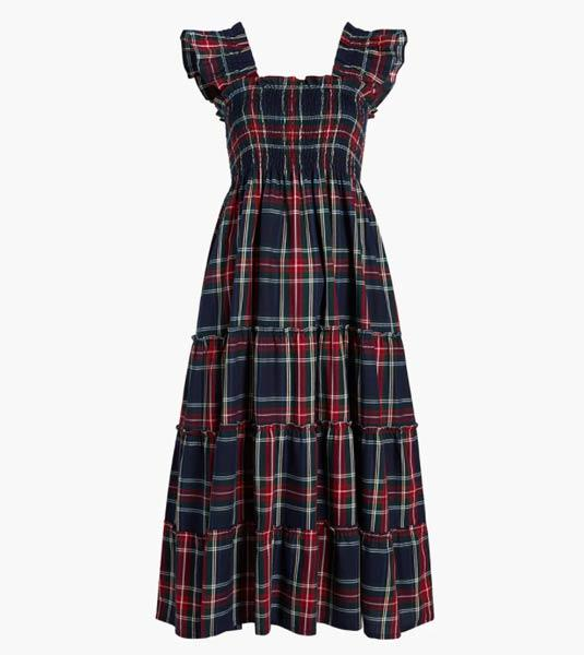 The royal wore an affordable and comfy tartan dress for her journey home. (Hill House)