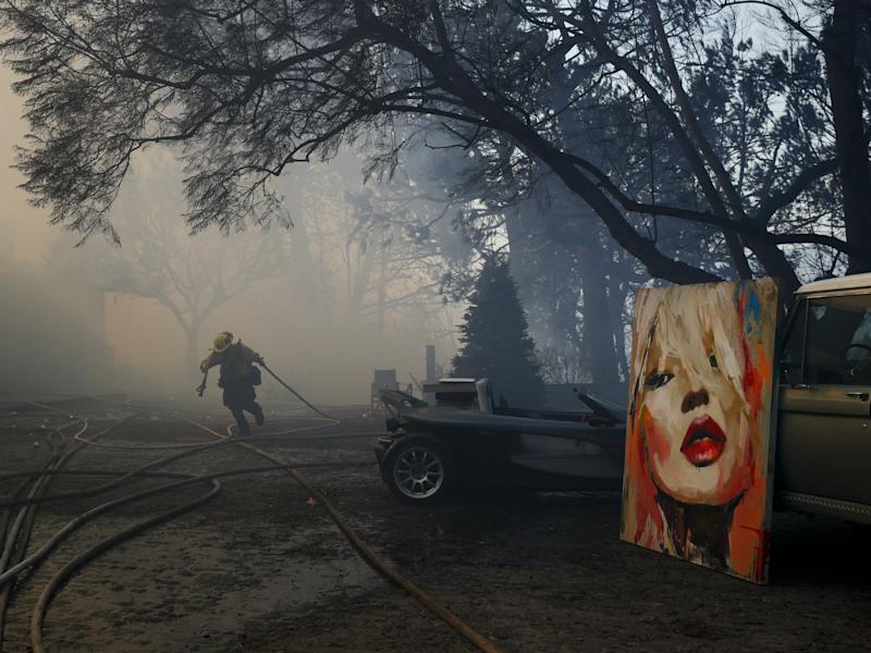 Firefighters have saved a number of paintings and other possessions in Bel Air: AP