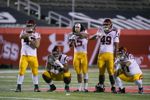 Southern California players pose for a photograph after their NCAA college football game against Utah Sunday, Nov. 22, 2020, in Salt Lake City. (AP Photo/Rick Bowmer)