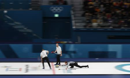 Curling - Pyeongchang 2018 Winter Olympics - Men's Tie-Breaker - Switzerland v Britain - Gangneung Curling Center - Gangneung, South Korea - February 22, 2018 - Kyle Smith of Britain delivers a stone. REUTERS/Cathal McNaughton