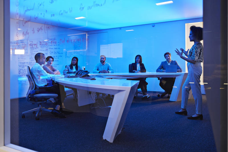Young businesswoman doing presentation in futuristic board room