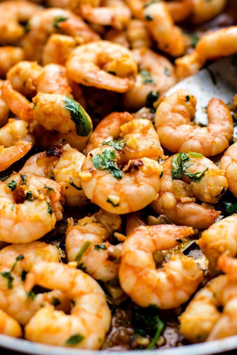 """<p>Dinner has never been easier! This slightly spicy and madly flavourful garlic coriander prawns dish comes together in minutes.</p><p>Get the <a href=""""https://www.delish.com/uk/cooking/recipes/a33466387/garlic-cilantro-shrimp-recipe/"""" rel=""""nofollow noopener"""" target=""""_blank"""" data-ylk=""""slk:Garlic Coriander Prawns"""" class=""""link rapid-noclick-resp"""">Garlic Coriander Prawns</a> recipe.</p>"""
