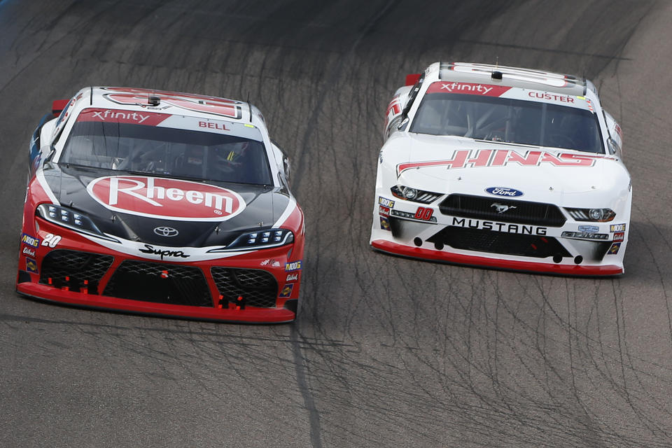 AVONDALE, ARIZONA - NOVEMBER 09: Christopher Bell, driver of the #20 Rheem Toyota, leads Cole Custer, driver of the #00 Haas Automation Ford, during the NASCAR Xfinity Series Desert Diamond Casino West Valley 200 at ISM Raceway on November 09, 2019 in Avondale, Arizona. (Photo by Jonathan Ferrey/Getty Images)