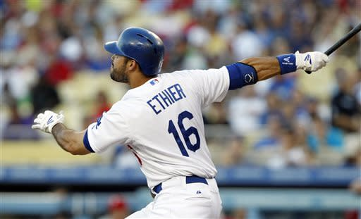 Los Angeles Dodgers' Andre Ethier watches his two-run double against the Philadelphia Phillies in the first inning of a baseball game Thursday, June 27, 2013, in Los Angeles. (AP Photo/Alex Gallardo)