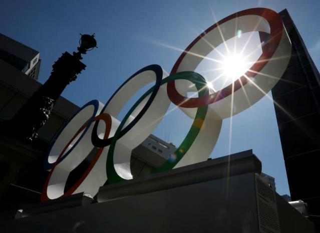 FILE PHOTO: Summer sunshine is seen through Olympic rings displayed at Nihonbashi district in Tokyo, Japan