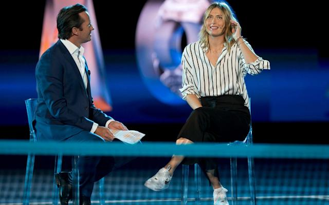 Maria Sharapova is interviewed on Margaret Court Arena during a ceremony for the official draw - AP