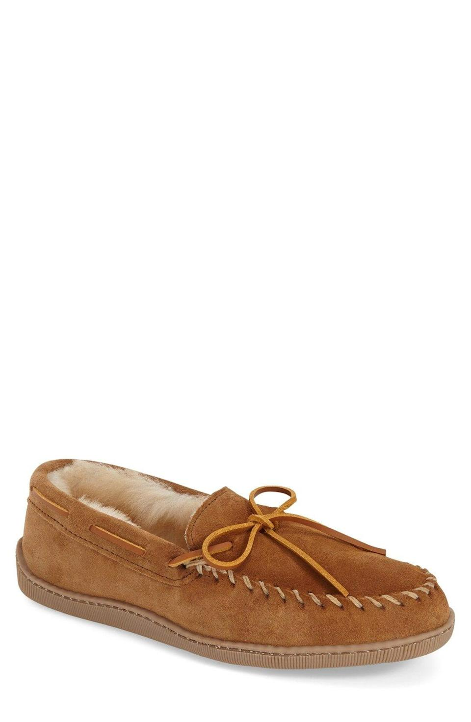 """<p><strong>Minnetonka</strong></p><p>nordstrom.com</p><p><strong>$69.95</strong></p><p><a href=""""https://go.redirectingat.com?id=74968X1596630&url=https%3A%2F%2Fshop.nordstrom.com%2Fs%2Fminnetonka-genuine-shearling-moccasin-slipper-men%2F4071734&sref=https%3A%2F%2Fwww.oprahdaily.com%2Flife%2Fg26961897%2Fgifts-for-new-dads%2F"""" rel=""""nofollow noopener"""" target=""""_blank"""" data-ylk=""""slk:Shop Now"""" class=""""link rapid-noclick-resp"""">Shop Now</a></p><p>If he lives in a multi-level home, one thing's for sure: Dad will be going up and down the stairs <em>a lot</em>. For his birthday, consider shearling slippers that will keep his feet cozy, plus have gripped bottoms to prevent him from slipping on those stairs.</p>"""