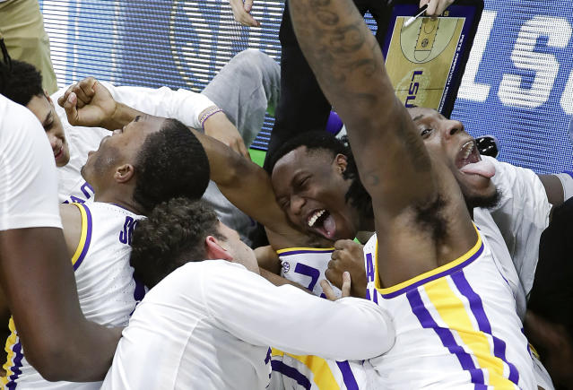 <p>LSU players celebrate after defeating Maryland 69-67 in a second-round game in the NCAA men's college basketball tournament in Jacksonville, Fla., Saturday, March 23, 2019. (AP Photo/John Raoux) </p>