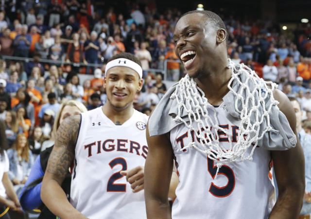 Auburn guard Mustapha Heron, right, celebrates after a victory against South Carolina on Saturday. (AP)