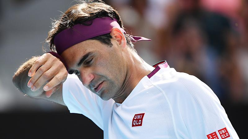 Roger Federer was forced to call for an injury timeout in the third set of his clash against Tennys Sandgren. (Photo by Hannah Peters/Getty Images)