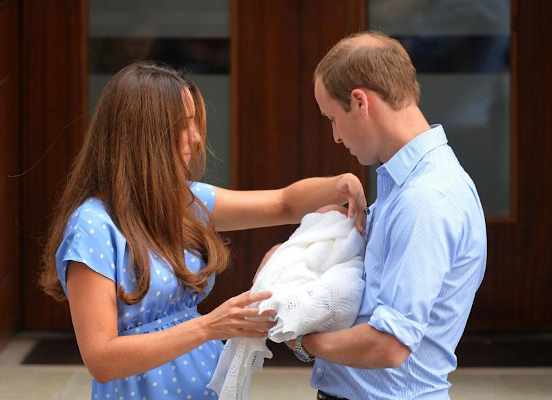 Prince William takes the baby from Catherine, Duchess of Cambridge as they show their new-born baby boy to the world's media outside the Lindo Wing of St Mary's Hospital in London on July 23, 2013. The baby was born on Monday afternoon weighing eight pounds six ounces (3.8 kilogrammes). The baby, titled His Royal Highness, Prince (name) of Cambridge, is directly in line to inherit the throne after Charles, Queen Elizabeth II's eldest son and heir, and his eldest son William.