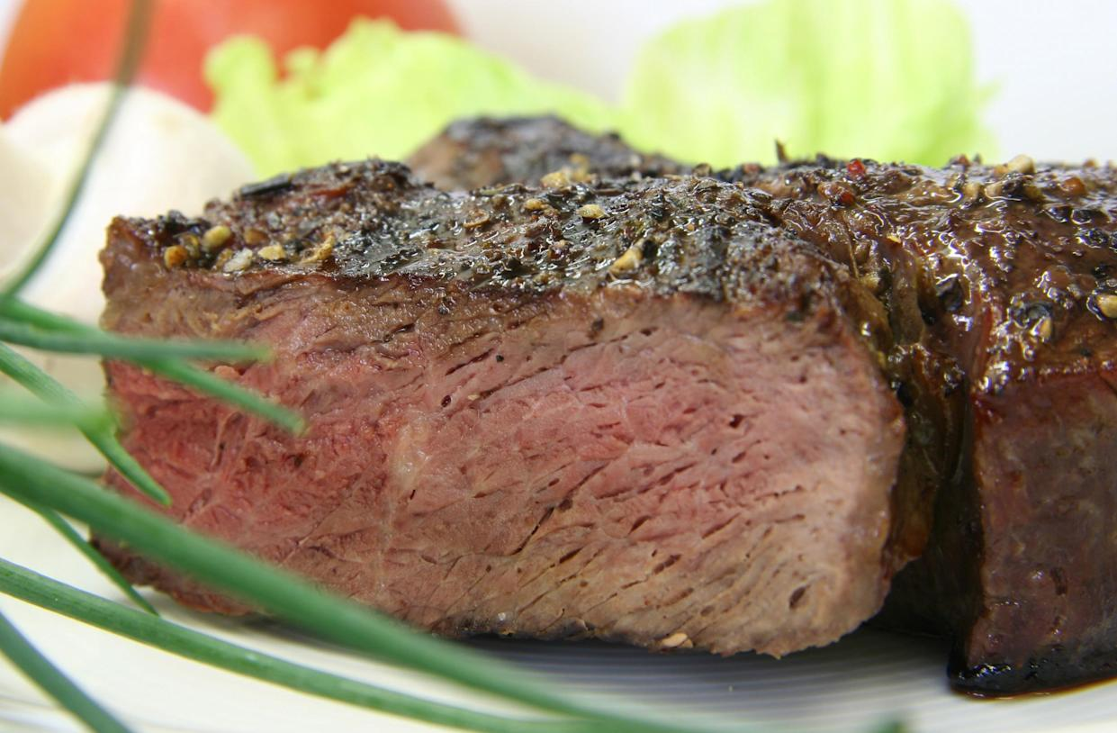 Like your steak medium-well? Cook it to an internal temperature of 140 to 145 degrees, depending on the meat's thickness.  (Getty Images)