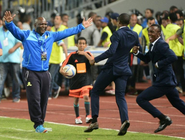 Mamelodi Sundowns coach Pitso Mosimane (L) celebrates winning the 2016 CAF Champions League