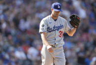 Los Angeles Dodgers starting pitcher Max Scherzer reacts after giving up a two-run home run to Colorado Rockies' Raimel Tapia in the fifth inning of a baseball game Thursday, Sept. 23, 2021, in Denver. (AP Photo/David Zalubowski)