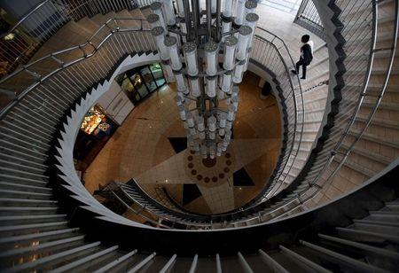 A man walks up a spiral staircase at a shopping mall at the Tokyo's Ginza shopping district, Japan, May 19, 2015.  REUTERS/Yuya Shino