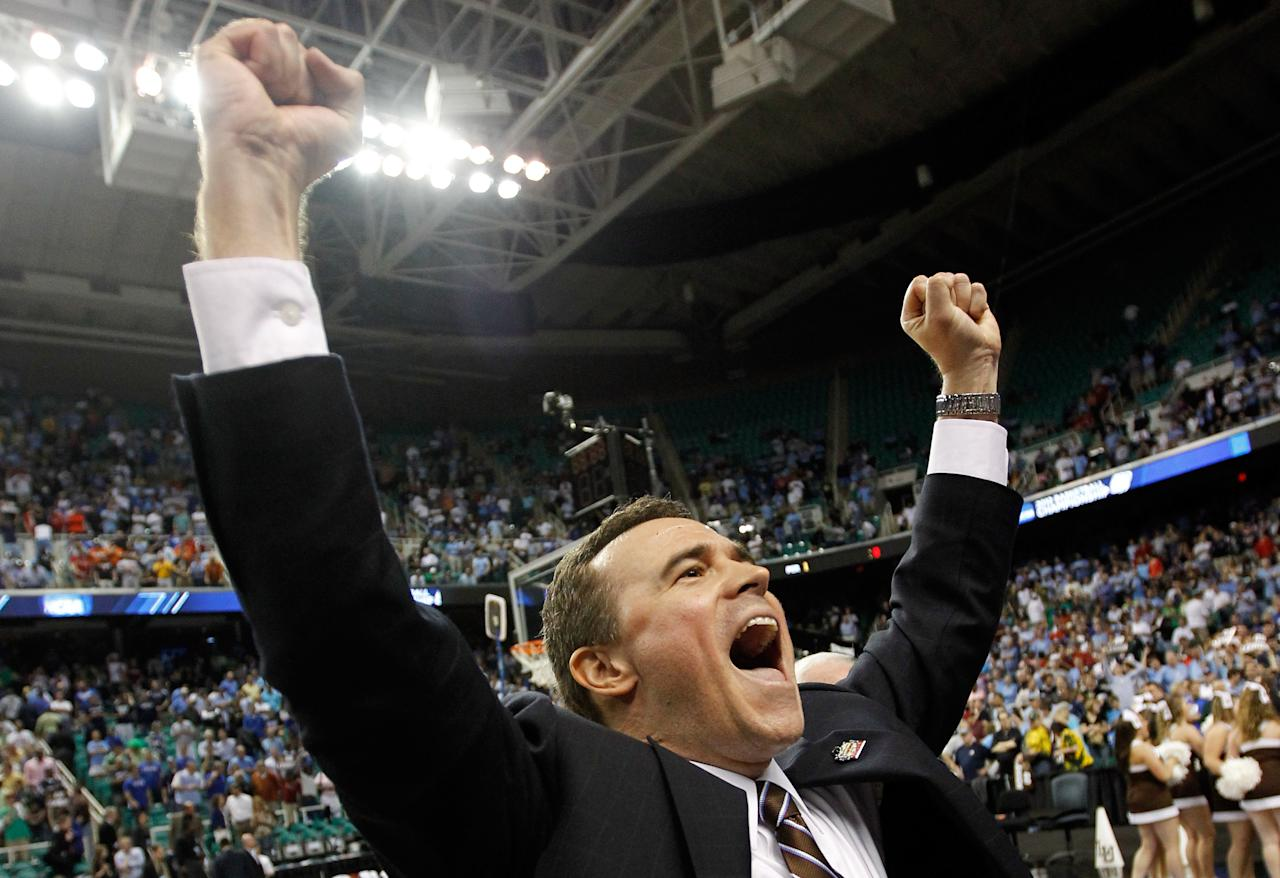 GREENSBORO, NC - MARCH 16:  Head coach Brett Reed of the Lehigh Mountain Hawks reacts after the Mountain Hawks defeat the db 75-70 during the second round of the 2012 NCAA Men's Basketball Tournament at Greensboro Coliseum on March 16, 2012 in Greensboro, North Carolina.  (Photo by Streeter Lecka/Getty Images)