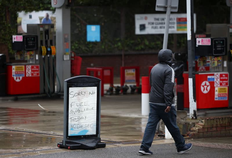 A sign informing customers that fuel has run out is pictured at a Texaco fuel station in London