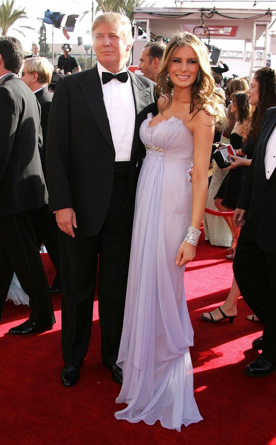 <p>Melania hit the Emmys red carpet in a pretty lilac dress made entirely out of lightweight chiffon. <i>[Photo: Getty]</i> </p>