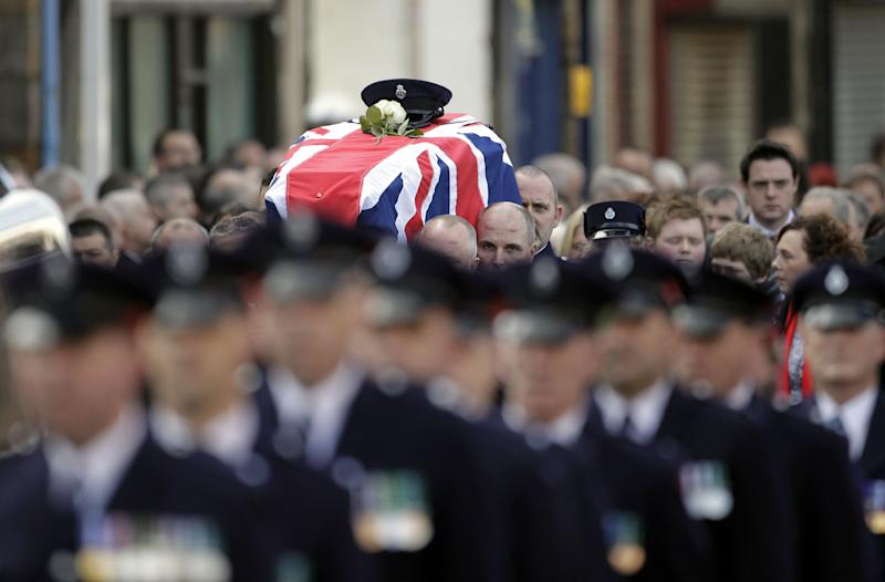 Prison Officers carry the coffin of their murdered colleague David Black to Molesworth Presbyterian Church in Cookstown, Northern Ireland, Tuesday, Nov. 6, 2012.  The father of two was shot dead by suspected paramilitary Irish Republican dissidents in County Armagh on Thursday as he drove to work at Maghaberry Prison.  (AP Photo/Peter Morrison