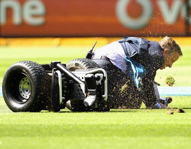 MELBOURNE, AUSTRALIA - DECEMBER 28:  Former Australian cricketer, TV commentator Ian Healy falls off the Segway cycle recreating an incident from yesterday where Joe the cameraman ran over a helmet and fell, during day three of the First Test match between Australia and India at the Melbourne Cricket Ground on December 28, 2011 in Melbourne, Australia.  (Photo by Mark Dadswell/Getty Images)