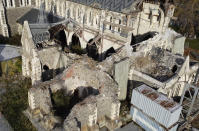 This shows an aerial view of 2011 earthquake damaged Christ Church Cathedral in central Christchurch, New Zealand, on May 11, 2020. The Christ Church Cathedral was arguably New Zealand's most iconic building before much of it crumbled during an earthquake 10 years ago. The years of debate that followed over whether the ruins should be rebuilt or demolished came to symbolize the paralysis that has sometimes afflicted the broader rebuild of Christchurch. But as the city on Monday, Feb. 22, 2021 marks one decade since the quake struck, killing 185 people and upending countless more lives, there are finally signs of progress on the cathedral. It's being rebuilt to look much like the original that was finished in 1904, only with modern-day improvements to make it warmer and safer. (AP Photo/Mark Baker)