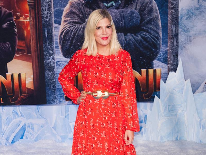 Tori Spelling apologises after photo of dressed-up daughter sparks racism accusations