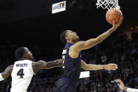 Butler guard Aaron Thompson (2) beats Providence guard Maliek White (4) to the basket during the first half of an NCAA college basketball game Friday, Jan. 10, 2020, in Providence, R.I. (AP Photo/Elise Amendola)