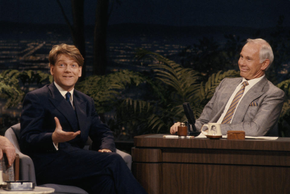 THE TONIGHT SHOW STARRING JOHNNY CARSON -- Air Date 02/01/1990 -- Pictured: (l-r) Actor Kenneth Branagh during an interview with host Johnny Carson on February 1, 1990 (Photo by Alice S. Hall/NBCU Photo Bank/NBCUniversal via Getty Images via Getty Images)
