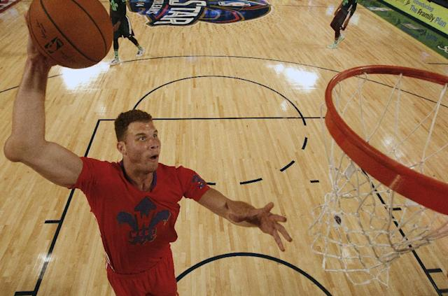 West Team's Blake Griffin, of the Los Angeles Clippers (32) heads to the hoop as East Team's LeBron James, of the Miami Heat (6) looks on during the NBA All Star basketball game, Sunday, Feb. 16, 2014, in New Orleans. (AP Photo/Gerald Herbert)